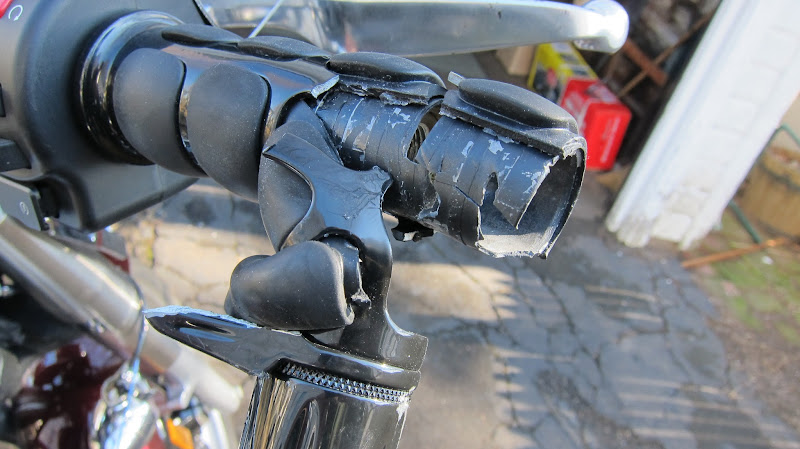 Photo: Kuryakyn ISO grips ripped apart, throttlebuster snapped, bar end weight destroyed