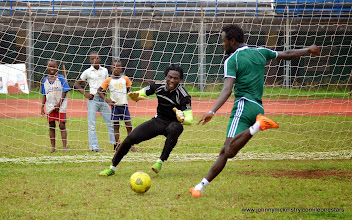 Photo: Kei Kamara shoots against Solomon 'Zombo' Morris  [Training Camp ahead of Leone Stars v Swaziland Game on 31 May 2014 (Pic: Darren McKinstry)]