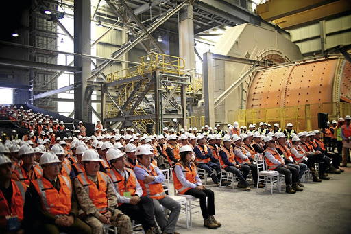 Reward:  Workers attend a ceremony at Escondida copper mine near Antofagasta, Chile, in 2016. They hope that collective action in 2017 will bring a 7% pay rise and a substantial bonus after the recovery in the metal's price. Picture: REUTERS
