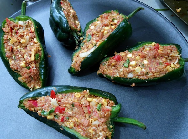 Place meat into pepper and gently but firmly press down into sides.  Bake...
