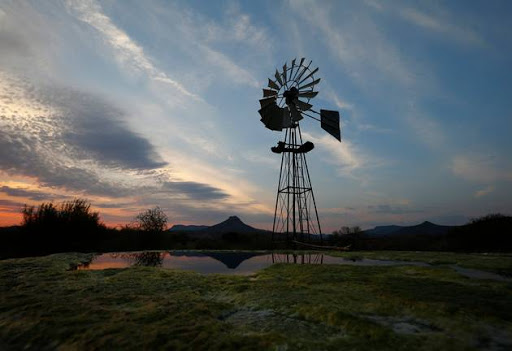 A windmill pumps water from a borehole near Graaf Reinet in the Karoo.