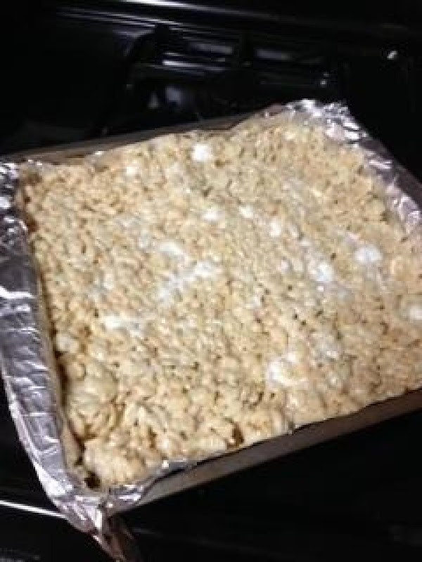 Pour mixture into prepared pan and press evenly into the pan.