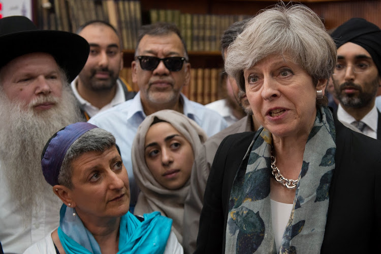 Britain's Prime Minister Theresa May speaks to faith leaders in Finsbury Park Mosque, near rthe scene of an attack, in London, Britain June 19, 2017.
