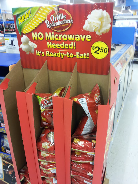 """Photo: There was """"no microwave"""" popcorn in a display by the DVDs. We already had popcorn at home, though, so I didn't grab any."""