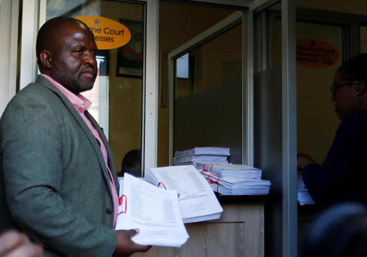 Tinomudaishe Chinyoka, one of the lawyers representing Zanu-PF's presidential candidate Emmerson Mnangagwa, arrives to file opposing papers at the Constitutional Court in Harare, Zimbabwe, on August 15 2018. Picture: REUTERS/PHILIMON BULAWAYO