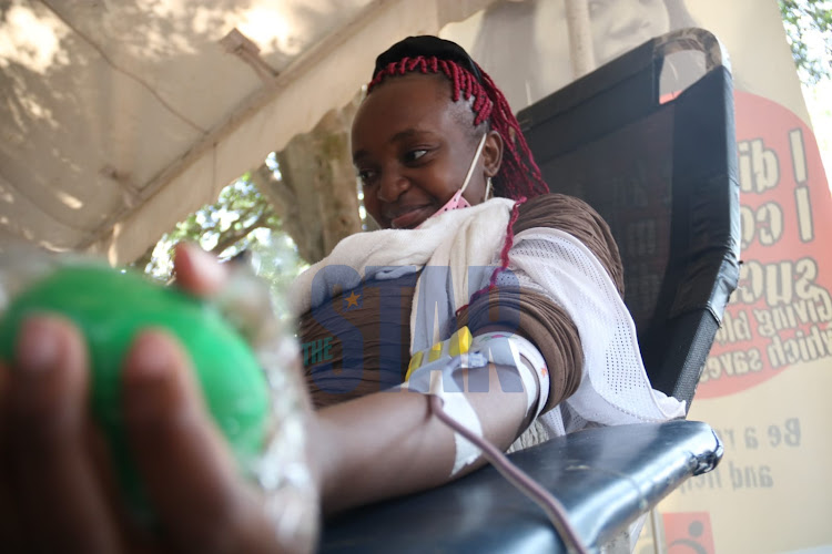 A woman donating blood during an exercise held by Kenya National Blood Transfusion Service in partnership with the coalition for blood Africa (CoBA) at Uhuru Park Nairobi on Monday, 8 March. /WILFRED NYANGARESI