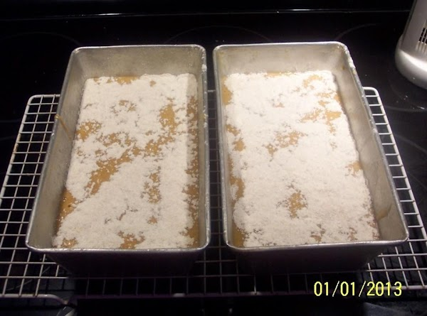 Divide the batter between the 2 loaf pans.Mix the strusel topping ingredients together...and sprinkle...