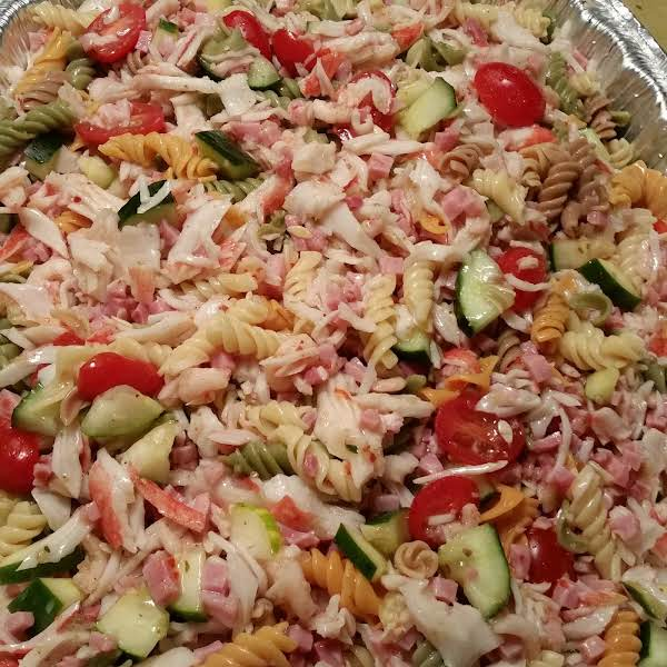 Seafood Pasta Salad. Boil Pasta For About 7 Minutes,  Add Cucumbers,  Tomatoes, Shrimp, Diced Ham, Crabmeat And A Bottle Of Zesty Italian Dressing!