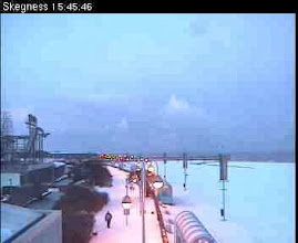 Photo: The first snows were melted by the salt on the sand. The second snows found young soil..Skegness beach white-over, from the webcam on the RNLI building.
