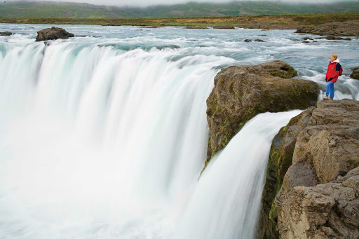 Lindblad-Expeditions-Iceland-Godafoss2.jpg - Take in the incredible sights when you visit the magnificent Godafoss Waterfall on a Lindblad Expeditions tour of Iceland.
