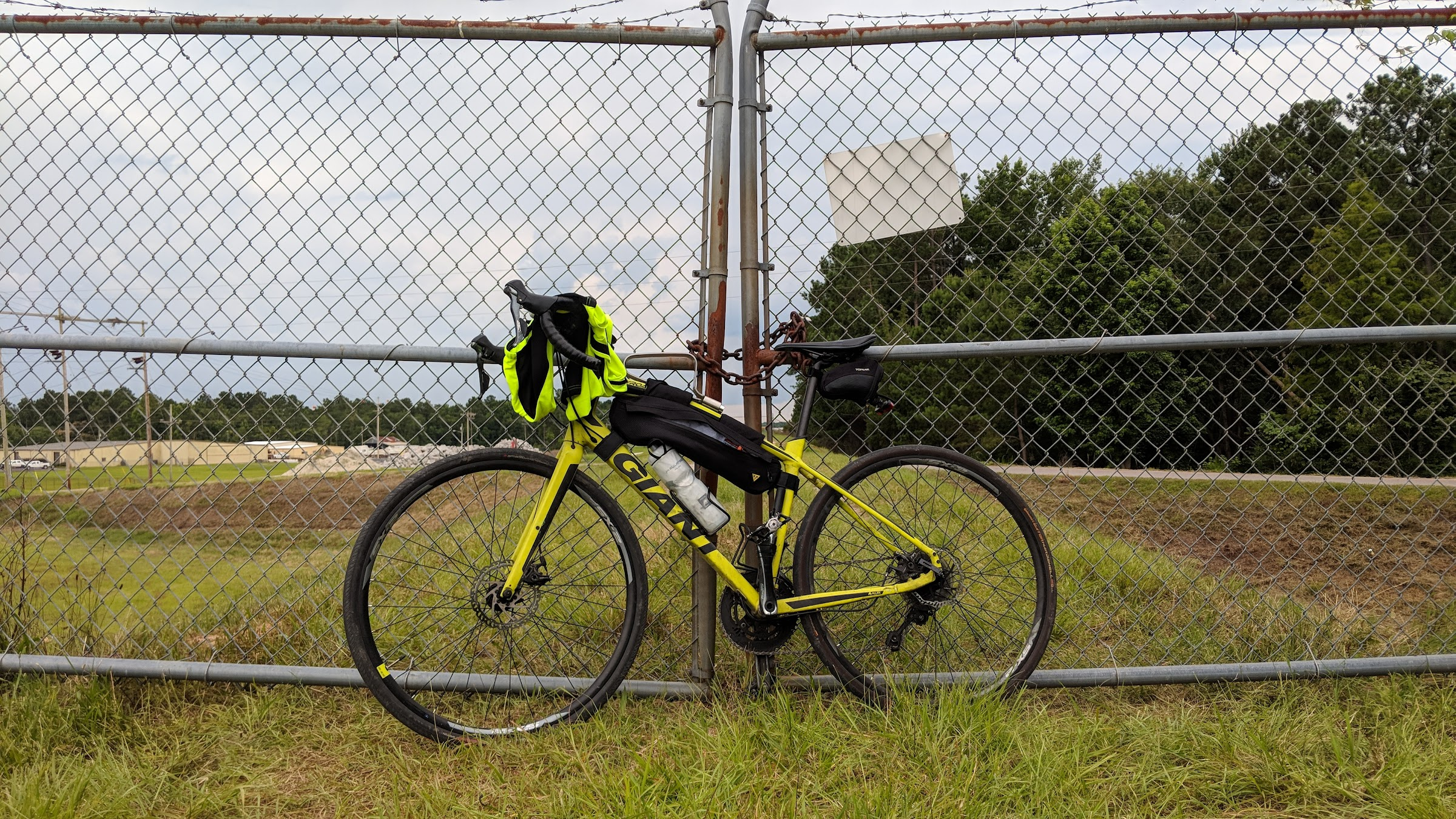 Giant Anyroad 1 bicycle leaning against lake Moultrie dike gate