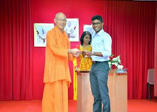 Photo: Mr Hari Aran Krishnan (O level) receiving the Award from Swamiji