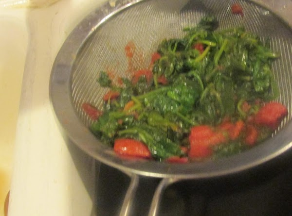 Remove skillet from heat and add spinach mixture to a strainer, and drain as...