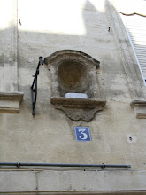 Photo: A not uncommon site in medieval towns were these small indentations in buildings, typically holding a statue of Mary, as a prayer for deliverance from war, plague, and other manners of suffering of the times. Sometimes the statue remains, and sometimes not.