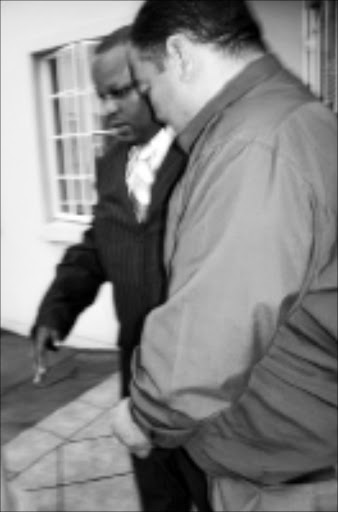 IN TROUBLE: Superintendent Clive Carstens, right, with Senior Superintendent Obed Ngwenya in Witbank yesterday. 28/01/09. © Unknown.