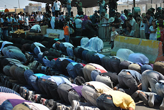 Photo: Muslims forbidden from worshipping at Al Aqsa mosque in Jersusalem, one of Islam's holiest sites, pray at Qalandiya checkpoint prior to the demonstration.