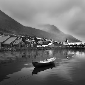 Siglo by Kaspars Dzenis - Black & White Landscapes ( water, reflection, iceland, black and white, town, boat, landscape )