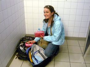 Photo: Amanda repacking at the airport!