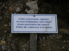 """Photo: A not uncommon sign in old cemeteries, noting a plot whose upkeep costs are no longer being paid, and so is scheduled for """"recovery,"""" unless arrangements are made at the town hall."""