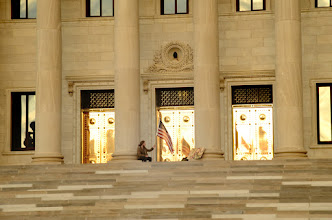 Photo: Not even sharp. This is for context. Small series coming up.  7:15 AM. doors of the Arkansas State Capitol.