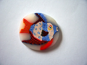 """Photo: Fish - 2, Color: Blue, Red, Gold, White, Black and more mixed multicolored fish. Very detailed. $6.00 per inch long with a Diameter of 1/2"""" inch around. $13.50 per inch long with a Diameter of 3/4"""" and $24.00 per inch long with a Diameter of 1""""."""