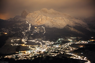 Photo: Nighttime lights of Cortina d' Ampezzo illuminate the mountains above town on a snowy November night.