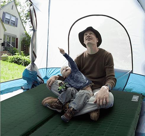 man with child on KAMUI sleeping pad