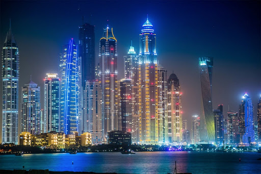 The skyline of Dubai in the United Arab Emirates at night.