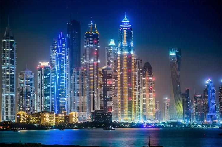 The skyline of Dubai in the United Arab Emirates at night.