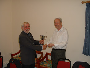 Photo: Nick Wingfield presenting Richard Carver with Wiltshire Minor trophy for Swindon 'B' - winners of 2011/2012 season.Wiltshire County Chess Association Executive Meeting,Langley Burrell Village Hall,Manor Farm Lane,Langley Burrell,Wiltshire.11th Sept. 2012