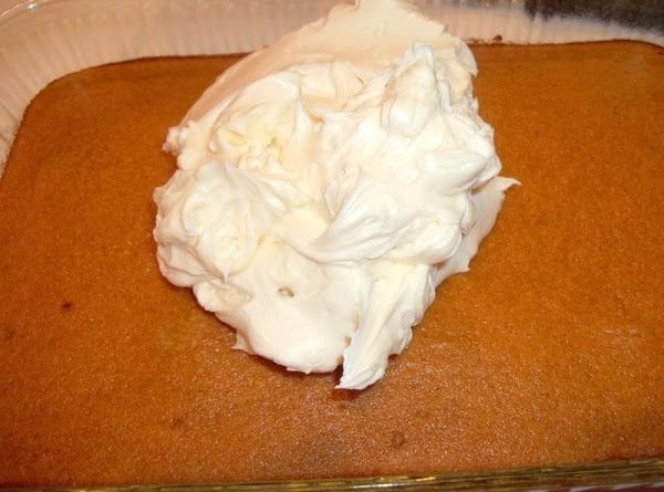 While cake cools, make frosting.  Mix the cream cheese and butter together until fluffy. Mix...