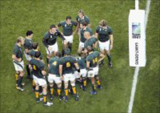 TEAM TALK: South African captain John Smit, centre left, rallies his teammates after an Argentina try during the Rugby World Cup semifinal between Argentina and South Africa, at the Stade de France Stadium in Saint Denis, near Paris, last Sunday. Pic. Matt Dunham. 14/10/07. © AP.
