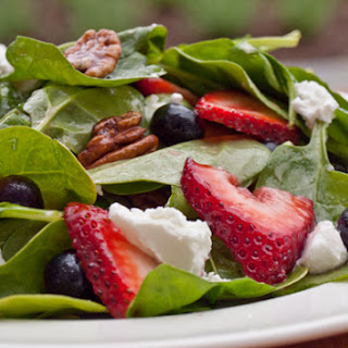 Baby Spinach with Fresh Berries, Pecans & Goat Cheese in Raspberry Vinaigrette.