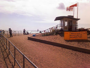 Photo: A steely reflective sea with a deep orange here at Skegness promenade, the sand baked more orange after 30°c temps a few days earlier.