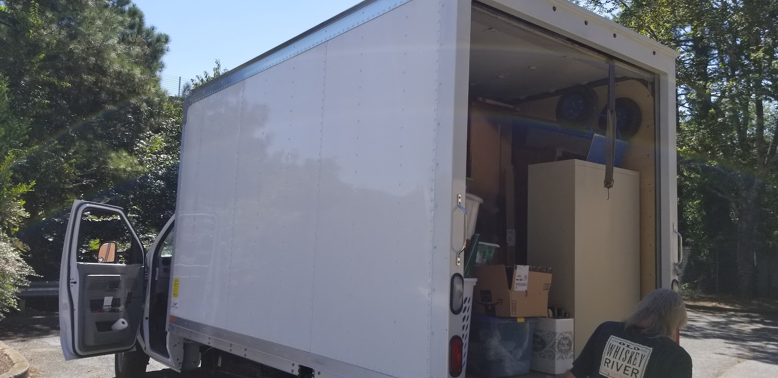 Image: one of several truckloads heading to Project Safe; the panel truck is filled to the top with file cabinets, chairs, desks, artwork, etc.