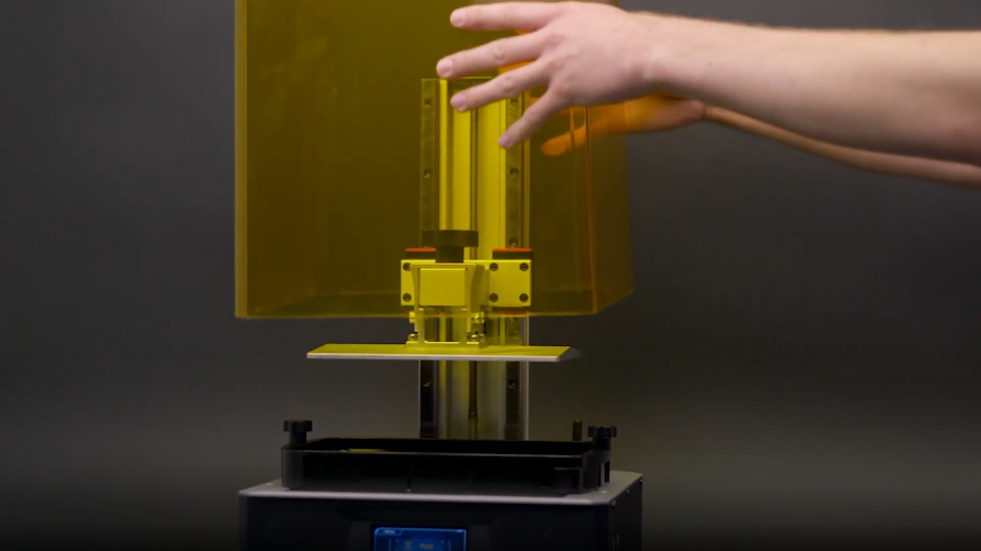 Simply lifting the acrylic cover of the Anycubic Photon Mono X (pictured) or the Anycubic Photon Mono is all you need to do to access the build plate or vat.