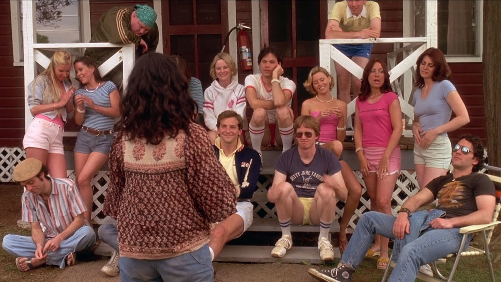 A majority of the ensemble cast and some extras gathered on the steps to one of the camp's cabins to listen to Camp Director Beth (Garofalo), who is faced with her back towards the camera.  Some are listening attentively (Susie/Poehler, Ben/Cooper and McKinley/Black) while Katie (Moreau) is talking with a girlfriend and gum-chewing Abby (Ryan) is facing another way. Andy (Rudd) is sitting on a chair next to the steps, wearing his sunglasses to add to his rebellious side.