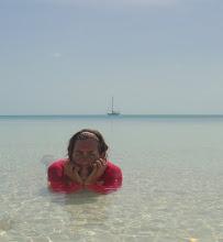 Photo: Anne soaking up sun & sand on Hoffman Cay