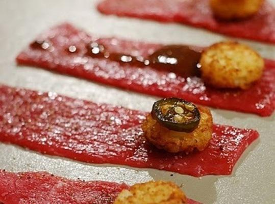 Bake tater tots according to package directions. Cut sirloin into 1x 5-inch strips. Note: you can...