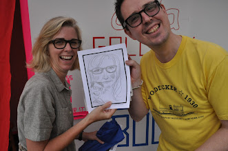 Photo: $5 gets you a sketch portrait at Daniel Davidson's picture booth (ADA Gallery)