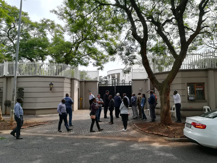Officials from various government enforcement agencies descended on the Gupta compound in Johannesburg on Monday, apparently as part of asset seizure operations. Picture: MZILIKAZI WA AFRIKA