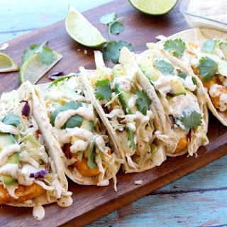 Fish Tacos with Creamy Avocado Salsa Verde Sauce.