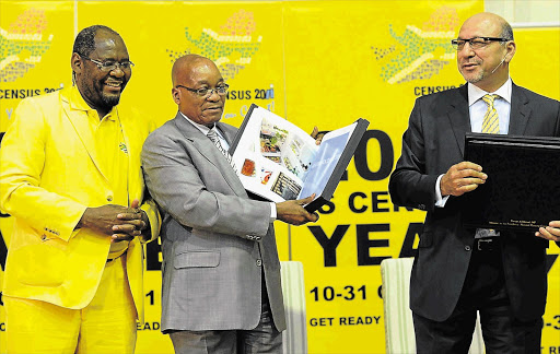 COUNTED: President Jacob Zuma, flanked by statistician-general Pali Lehohla and Minister in the Presidency Trevor Manuel, at the release of the census results Picture: SIYABULELA DUDA