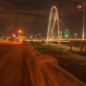 Margaret Hunt Hill Bridge & Commerce Street Viaduct by Michael McMurray - Buildings & Architecture Bridges & Suspended Structures ( night exposure, hdr, trinity river, dallas, park at night, texas, commerce street viaduct, nighttime in the city, flag, suspension bridge, night life, street at night, long exposure, bridge, city at night, margaret hunt hill bridge, nightlife )