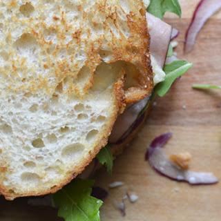 Toasted Cheddar, Ham & Arugula Sandwiches.