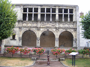 Photo: This is the Renaissance façade of a house built in the mid-16th century for Nicolas Chabouillé, finance minister to King François I. According to the information plaque, the decorative elements around the three large arches, include. Italian inspired motifs such as the medallion-style in wreaths of foliage. the representation of the elements by deities, and Roman pillars at the bottom (Neptune, Atlas, Vulcan and Aeolus). Also, the owner wanted to show its commitment to the sovereign by including the emblem of François I, the salamander. This building was purchased by Colonel Brack and given to his mistress, the actress Miss Mars, and became the façade of a Paris mansion. The building passed through various owners, and when the property was finally sold to a developer, the façade was returned here in 1956.