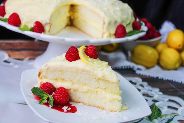 A Slice Of Limoncello Creme Cake On A Plate.