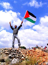 Photo: Bassam Abu Rahme, 2007, non-violently protesting the Israeli theft of Bil'in land, killed April 2009 by the IOF.  Allah yerhamo ya Bassam. http://www.bilin-village.org/english/articles/different-look/His-name-was-Bassem