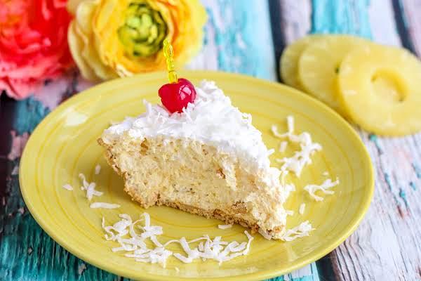 A Slice Of Hawaiian Pie On A Plate.