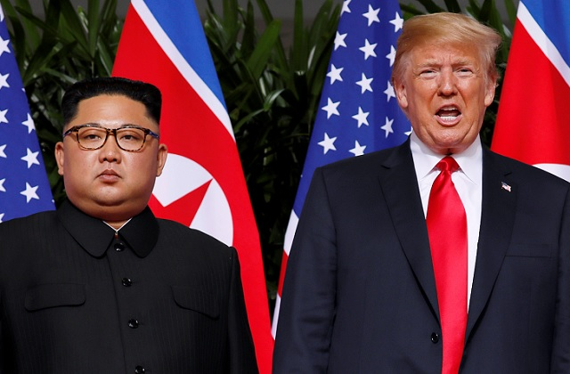 U.S. President Donald Trump and North Korean leader Kim Jong Un react at the Capella Hotel on Sentosa island in Singapore June 12, 2018.